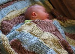 Плед спицами для новорожденного с описанием и схемами